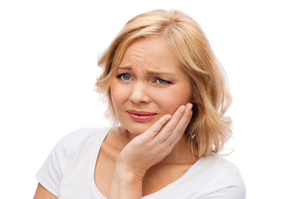Unhappy woman suffering from jaw pain